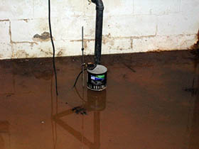 Flooded basement with sump pump disabled by power outage.