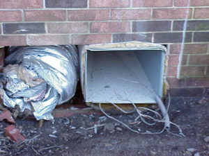 Exposed ductwork in foundation where AC unit has been removed.